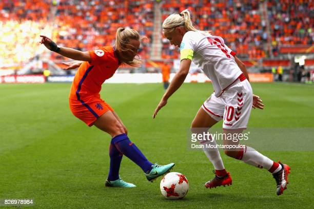 Pernille Harder of Denmark takes on Desiree van Lunteren of the Netherlands during the Final of the UEFA Women's Euro 2017 between Netherlands v...