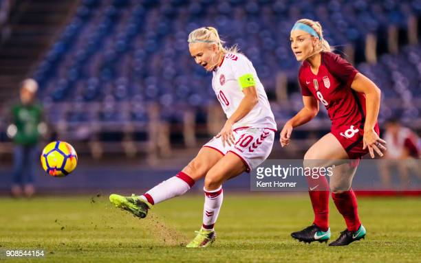 Pernille Harder of the Danish women's national team passes the ball during the first half against against Julie Ertz of the US women's national team...