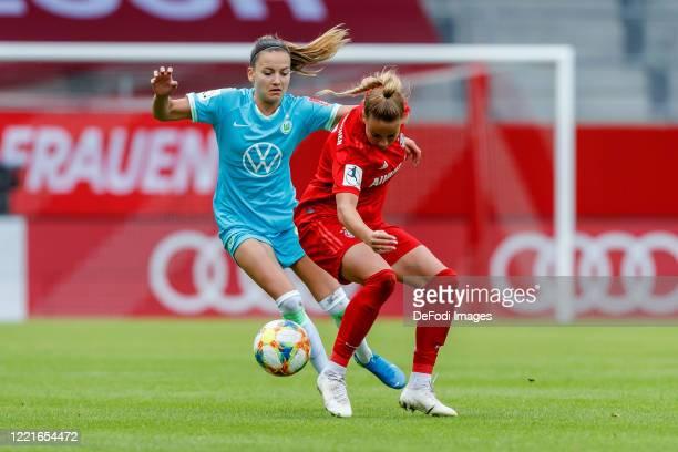 Pernille Harder of VfL Wolfsburg and Giulia Gwinn of Bayern Munich battle for the ball during the Flyeralarm Frauen Bundesliga match between FC...