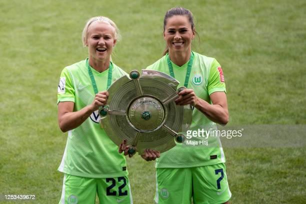 Pernille Harder of VfL Wolfsburg and Sara Bjoerk Gunnarsdottir of VfL Wolfsburg celebrate winning the championship following the Flyeralarm Frauen...