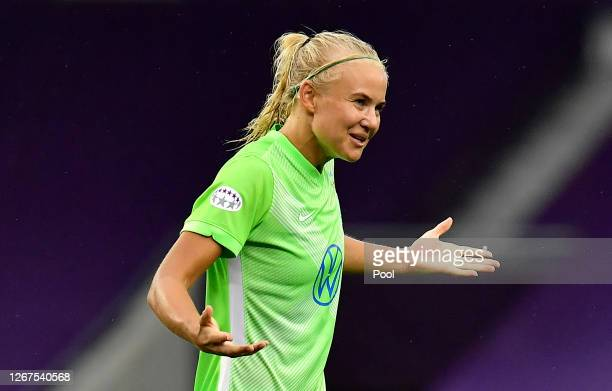 Pernille Harder of VfL Wolfsburg celebrates after scoring her team's fourth goal during the UEFA Women's Champions League Quarter Final between...
