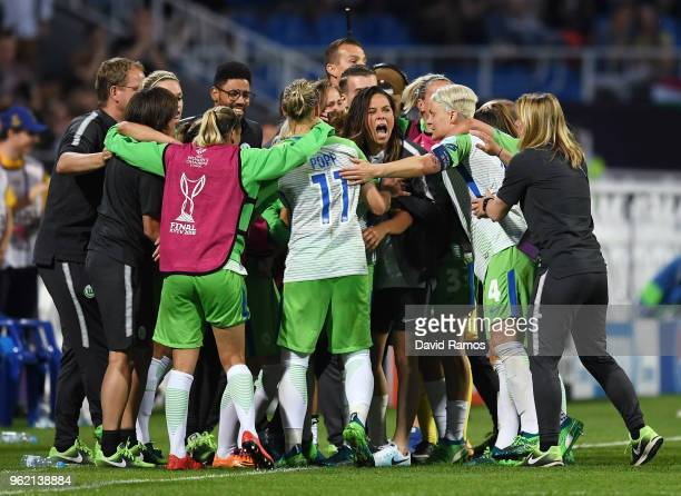 Pernille Harder of Vfl Wolfsburg celebrates scoring her sides first goal with team mates during the UEFA Womens Champions League Final between VfL...