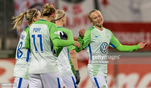 Pernille Harder of VfL Wolfsburg celebrates with team mates after scoring her team's fourth goal during the UEFA Women's Champions League Quarter...