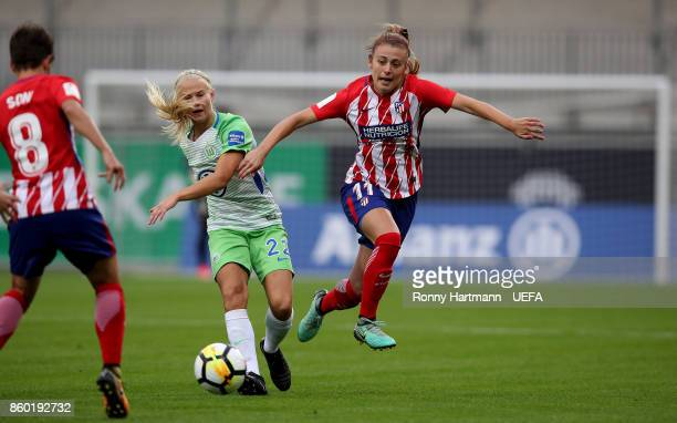 Pernille Harder of Wolfsburg and Carmen Menayo of Madrid vie during the UEFA Women Champions League Round of 32 second leg match between VFL...