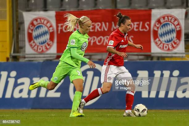 Pernille Harder of Wolfsburg and Gina Lewandowski of Bayern Muenchen battle for the ball during the Women's DFB Cup Quarter Final match between FC...