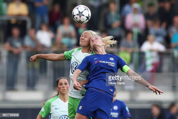 Pernille Harder of Wolfsburg and Katie Chapman of Chelsea compete for the ball during the Women's UEFA Champions League semi final second leg match...