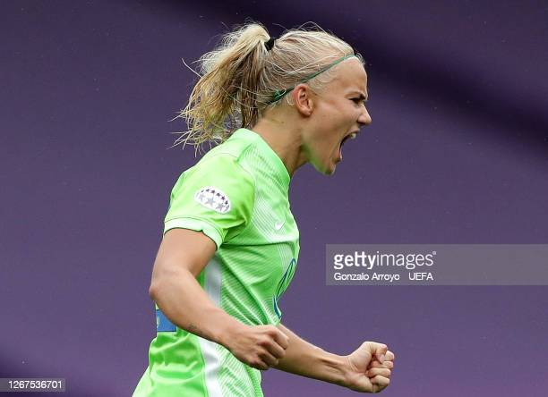 Pernille Harder of Wolfsburg celebrates after scoring her team's first goal during the UEFA Women's Champions League Quarter Final between Glasgow...