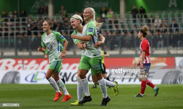 Pernille Harder of Wolfsburg celebrates after scoring with Nilla Fischer and Tessa Wullaert of Wolfsburg during the UEFA Women Champions League Round...