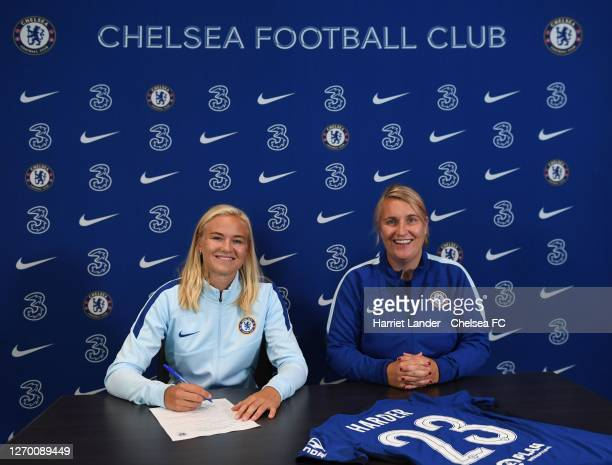 Pernille Harder poses for a photo with Emma Hayes Manager of Chelsea as she signs for Chelsea FC Women at Stamford Bridge on September 01 2020 in...