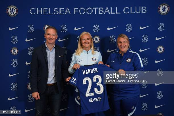 Pernille Harder poses for a photo with Paul Green General Manager of Chelsea and Emma Hayes Manager of Chelsea as she signs for Chelsea FC Women at...
