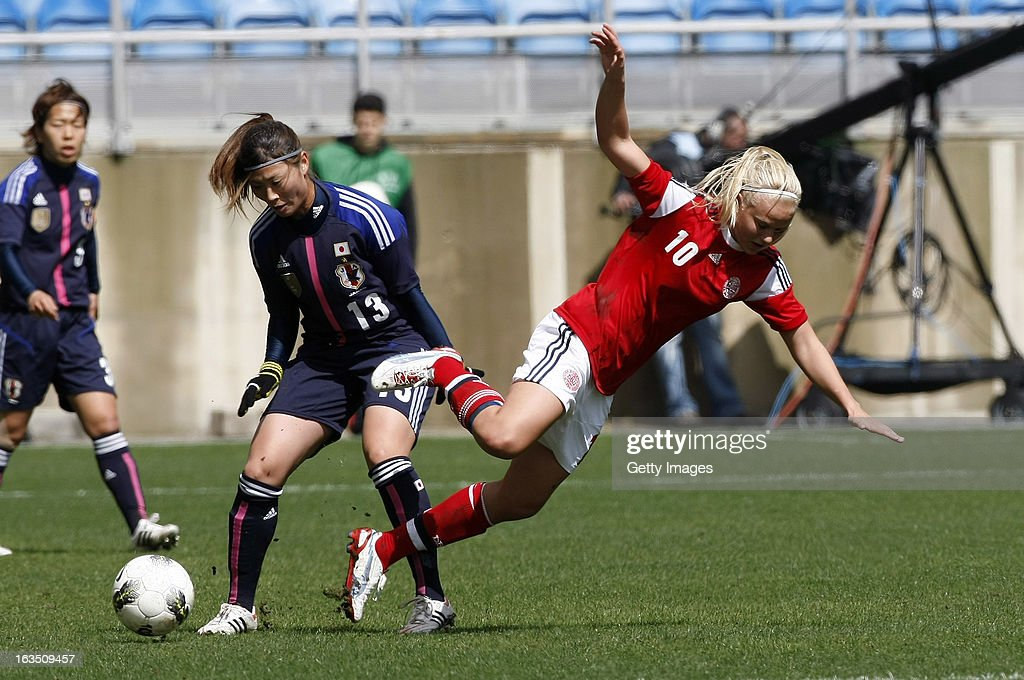Pernille M. Harder (R) of Denmark challenges Rumi Utsugi of Japan during the Algarve Cup 2013 match between Denmark and Japan at the Algarve Stadium on March 11, 2013 in Faro, Portugal.