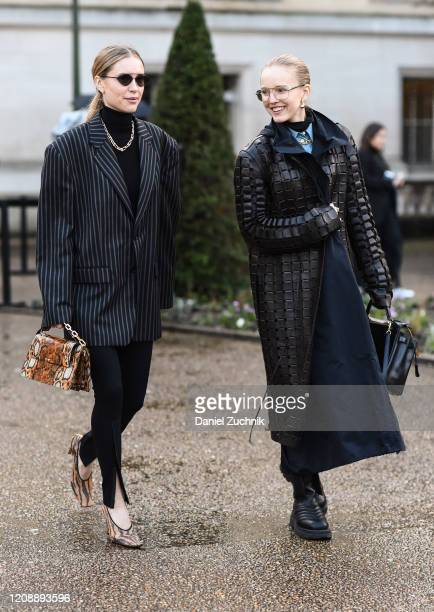Pernille Teisbaek and Alexandra Carl are seen outside the Maison Margiela show during Paris Fashion Week: AW20 on February 26, 2020 in Paris, France.