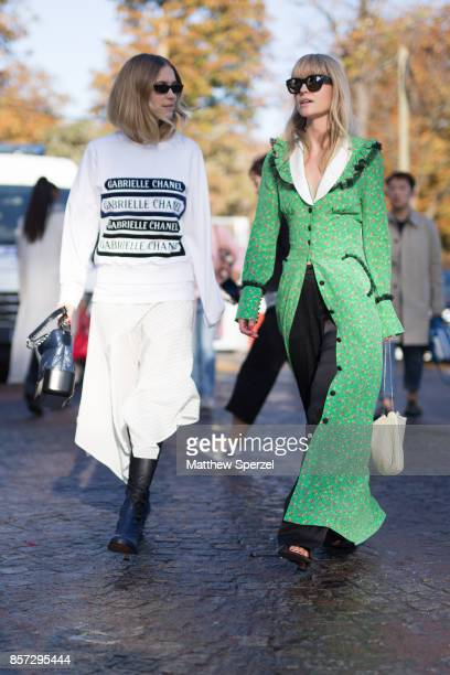 Pernille Teisbaek and Jeanette Madsen are seen attending Chanel during Paris Fashion Week wearing Chanel on October 3 2017 in Paris France