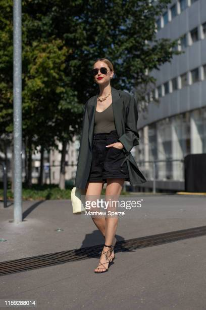 Pernille Teisbaek is seen on the street during Paris Haute Couture Fashion Week wearing Acne Studios on June 30, 2019 in Paris, France.