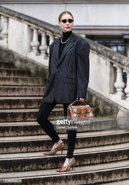 Pernille Teisbaek is seen wearing a Margiela jacket, and snakeskin bag and heels outside the Maison Margiela show during Paris Fashion Week: AW20 on...