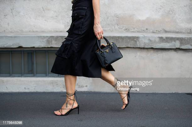 Pernille Teisbaek is seen wearing black Prada skirt with pockets, bag, sandals outside the Prada show during Milan Fashion Week Spring/Summer 2020 on...