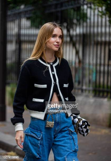 Pernille Teisbaek is seen wearing denim jeans with pockets, cardigan, checkered Chanel bag, heels, micro bag outside Chanel on July 06, 2021 in...