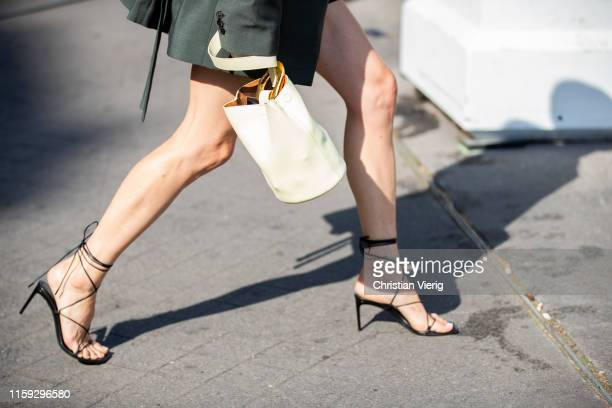 Pernille Teisbaek is seen wearing green blazer sandals yellow bag outside Acne during Paris Fashion Week Haute Couture Fall/Winter 2019/2020 on June...