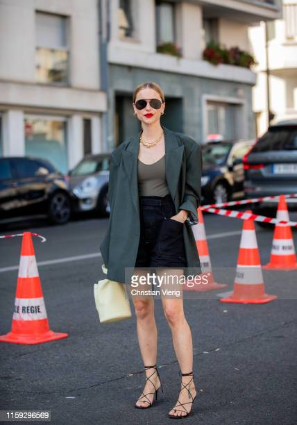 Pernille Teisbaek is seen wearing green blazer, shorts outside Acne during Paris Fashion Week - Haute Couture Fall/Winter 2019/2020 on June 30, 2019...