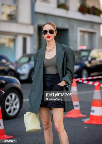 Pernille Teisbaek is seen wearing green blazer shorts outside Acne during Paris Fashion Week Haute Couture Fall/Winter 2019/2020 on June 30 2019 in...
