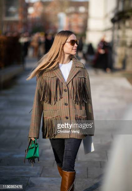 Pernille Teisbaek is seen wearing jacket with fringes Hermes bag brown boots denim jeans outside Victoria Beckham during London Fashion Week February...