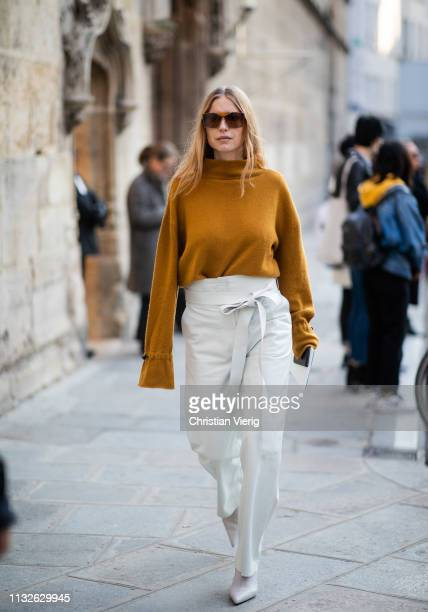Pernille Teisbaek is seen wearing ocher knit high waist white pants outside Lanvin during Paris Fashion Week Womenswear Fall/Winter 2019/2020 on...