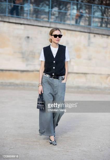 Pernille Teisbaek is seen wearing vest, wide leg grey pants, Dior bag outside Dior during Paris Fashion Week - Womenswear Fall/Winter 2020/2021 : Day...
