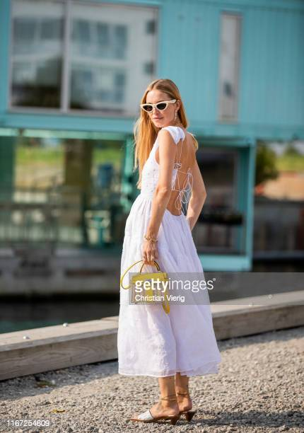 Pernille Teisbaek is seen wearing white dress outside Cecilie Bahnsen during Copenhagen Fashion Week Spring/Summer 2020 on August 07, 2019 in...