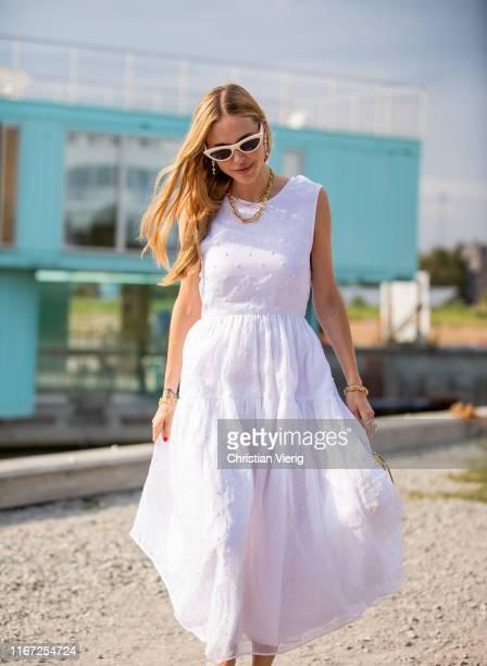 Pernille Teisbaek is seen wearing white dress outside Cecilie Bahnsen during Copenhagen Fashion Week Spring/Summer 2020 on August 07, 2019 in...