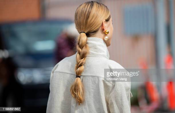 Pernille Teisbaek is seen with pigtail outside By Malene Birger during Copenhagen Fashion Week Spring/Summer 2020 on August 08, 2019 in Copenhagen,...