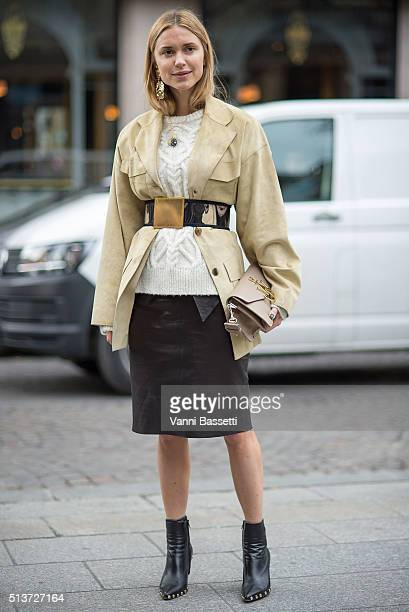 Pernille Teisbaek poses with a JW Anderson bag before the Isabel Marant show at Place Colette during Paris Fashion Week FW 16/17 on March 4 2016 in...