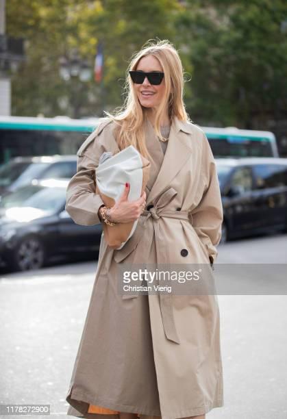 Pernille Teisbaek seen wearing brown trench coat, bag outside Stella McCartney during Paris Fashion Week Womenswear Spring Summer 2020 on September...
