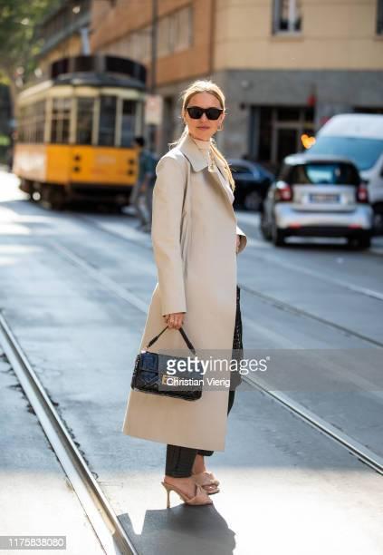 Pernille Teisbaek seen wearing creme white coat Fendi bag Bottega Veneta shoes LIDO PS20 outside Attico during Milan Fashion Week Spring/Summer 2020...