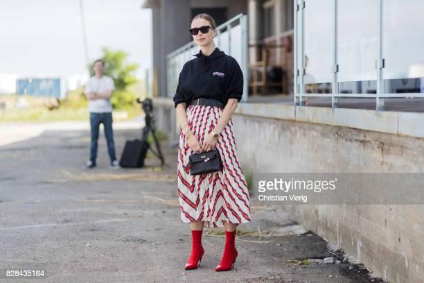 Pernille Teisbaek wearing a Balenciaga hoody striped skirt outside By Malene Birger on August 09 2017 in Copenhagen Denmark