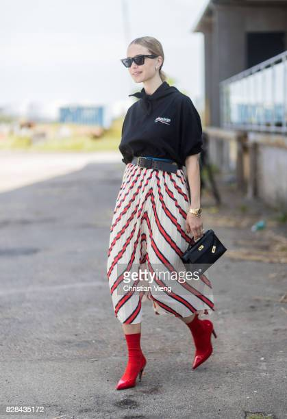 Pernille Teisbaek wearing a Balenciaga hoody striped skirt outside By Malene Birger on August 09 2017 in Copenhagen Denmark