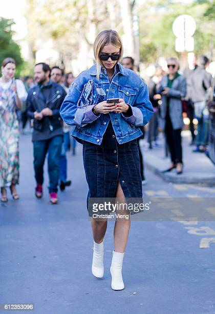 Pernille Teisbaek wearing a Chanel bag and denim jacket outside Sacai on October 3 2016 in Paris France