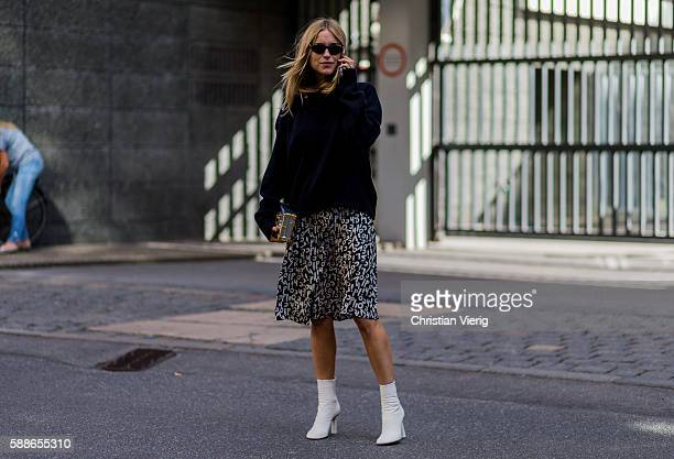 Pernille Teisbaek wearing a Lovechild skirt Louis Vuitton bag and Vetements heels outside Baum und Pferdgarten during the second day of the...