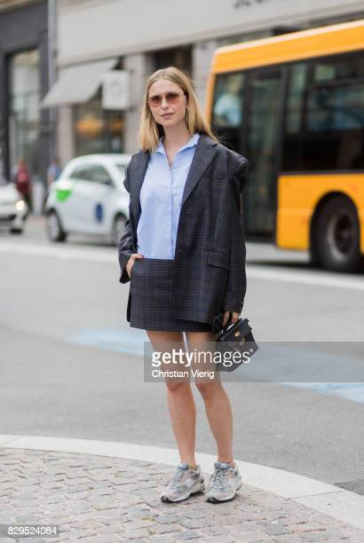 Pernille Teisbaek wearing a plaid blazer jacket and mini skirt button shirt outside Baum Und Pferdgarten on August 10 2017 in Copenhagen Denmark