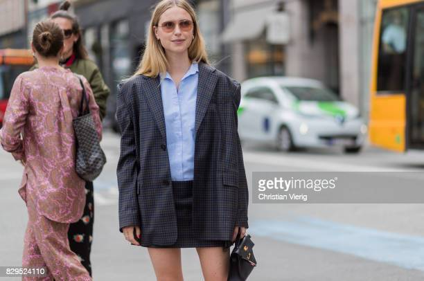 Pernille Teisbaek wearing a plaid blazer jacket and mini skirt button shirt outside Baum Und Pferdgarten on August 10 2017 in Copenhagen Denmark