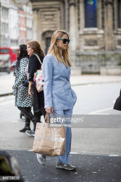Pernille Teisbaek wearing baby blue suit Comme des Garcons bag outside AWAKE during London Fashion Week September 2017 on September 19 2017 in London...