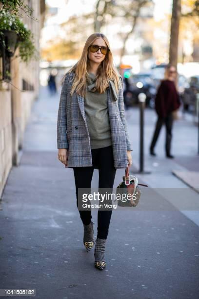 Pernille Teisbaek wearing Balenciaga heels Loewe bag grey checked blazer is seen outside Dries van Noten during Paris Fashion Week Womenswear...