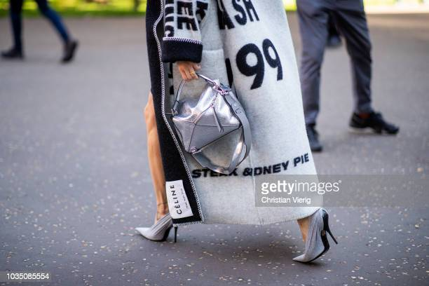 Pernille Teisbaek wearing Celine coat silver Loewe bag Balenciaga heels is seen outside Christopher Kane during London Fashion Week September 2018 on...