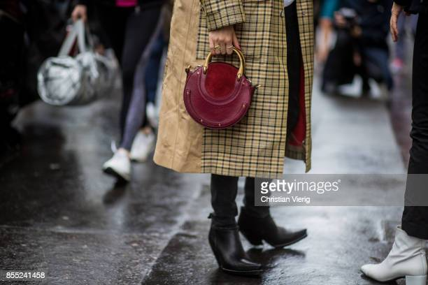 Pernille Teisbaek wearing checked coat Chloe bag is seen outside Chloe during Paris Fashion Week Spring/Summer 2018 on September 28 2017 in Paris...