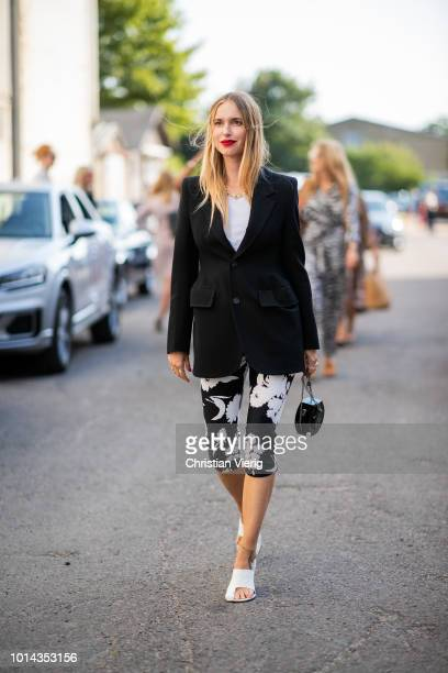 Pernille Teisbaek wearing cropped leggings black blazer jacket is seen outside Ganni during the Copenhagen Fashion Week Spring/Summer 2019 on August...