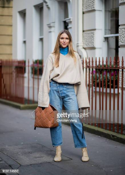 Pernille Teisbaek wearing denim jeans blue turtleneck creme white sweater with long sleeves seen brown bag outside Mulberry during London Fashion...