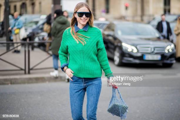 Pernille Teisbaek wearing denim jeans green knit is seen outside Miu Miu during Paris Fashion Week Womenswear Fall/Winter 2018/2019 on March 6 2018...