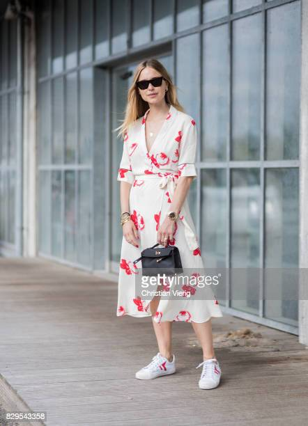 Pernille Teisbaek wearing dress outside Ganni on August 10, 2017 in Copenhagen, Denmark.