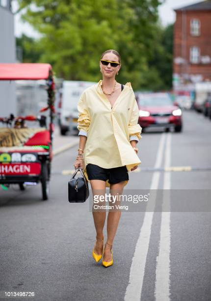 Pernille Teisbaek wearing Prada bag yellow button shirt balck skirt seen outside Stine Goya during the Copenhagen Fashion Week Spring/Summer 2019 on...