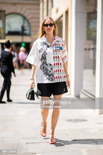 Pernille Teisbaek wearing Prada button shirts and shorts is seen outside Hermes Resort during Paris Fashion Week Haute Couture FW18 on July 1 2018 in...