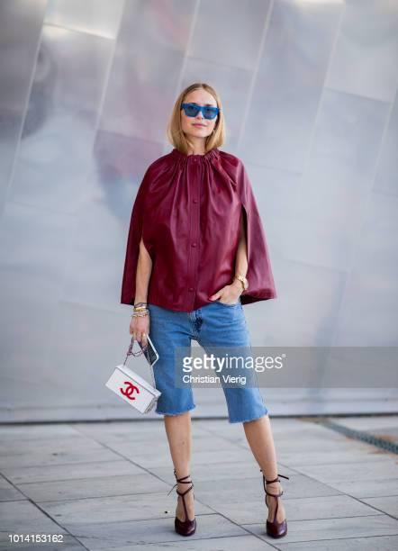 190db0e41dec3 Pernille Teisbaek wearing red cape skinny denim jeans is seen outside  Designers Remix during the Copenhagen
